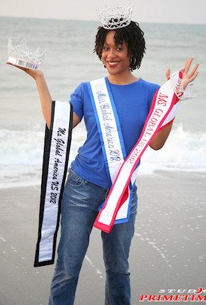 Aysha Cooper showing her 3 Titles