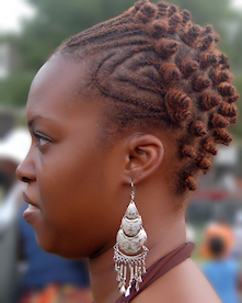 Woman with cornrows and bantus