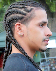 Man with cornrows