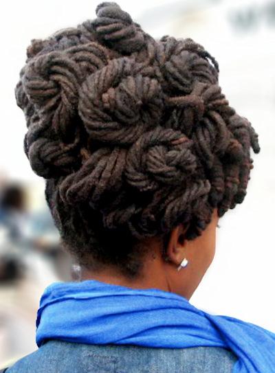 Long dreadlocks in an updo of natural hair