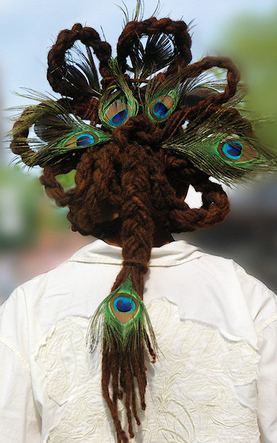 long Dreadlocks styled with peacock feathters